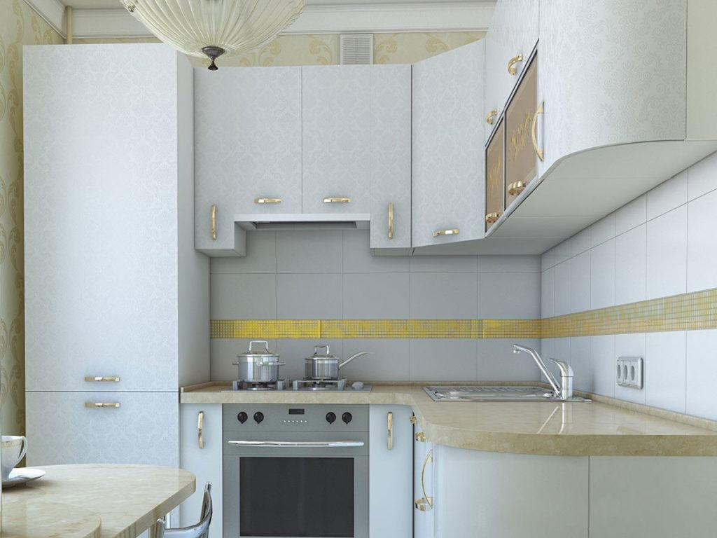 Холодильник белого цвета в интерьере светлой кухни