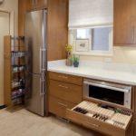 Холодильник в интерьере кухни в угловом шкафу