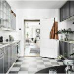 Серая палитра кухни в металлических тонах разбавлены белым