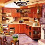 Дизайн кухни в частном доме с камином в стиле рустик