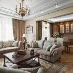 Оформление гостиной с диванами и креслами в центре
