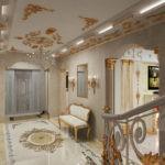 Оформление прихожей в стиле барокко с позолоченной лепниной и орнаментом на полу