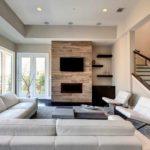 пример применения необычного стиля гостиной комнаты с камином фото