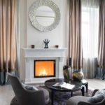 вариант использования красивого интерьера гостиной комнаты с камином картинка