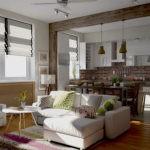 Светлый диван в кухне-гостиной стиля лофт