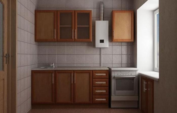 Белая газовая колонка на кухне с коричневым гарнитуром