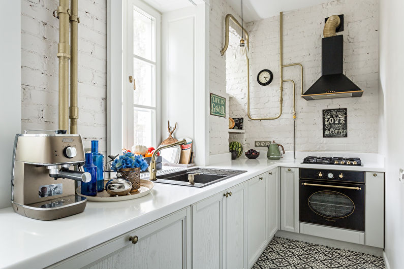 Оформление вытянутой кухни в белом цвете