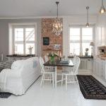 Белый диван в кухне-студии