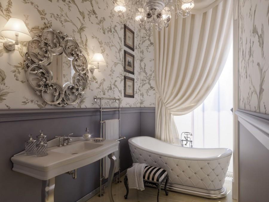 Зеркало в красивой рамке на стене ванной комнаты