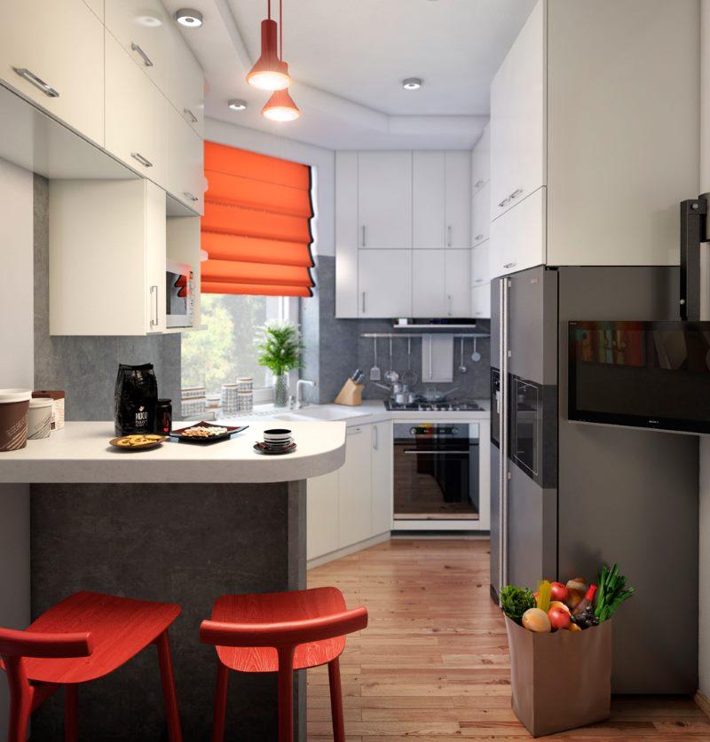 Акценты красного цвета в белой кухне-студии