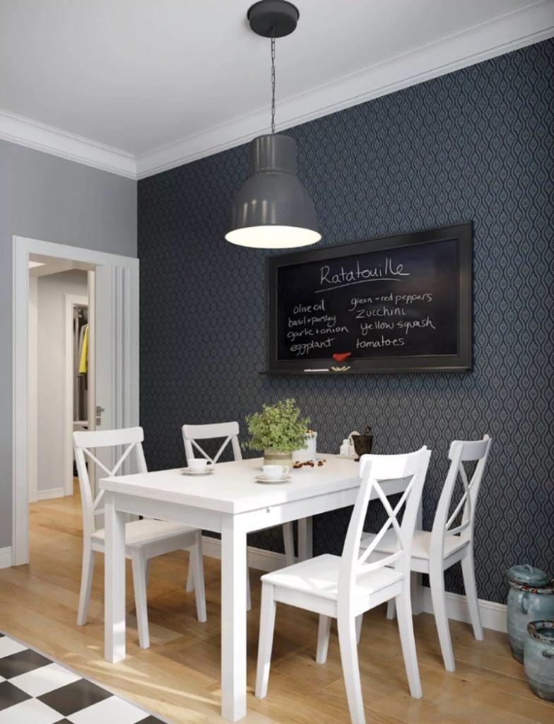 Светильник с серым плафоном над обеденным столом белого цвета