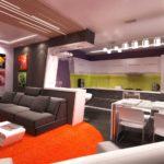 Кухня студия с барной стойкой, отделяющей рабочую зону от гостиной