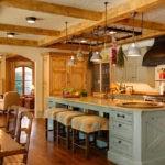 Просторная кухня в деревянном доме в стиле прованс