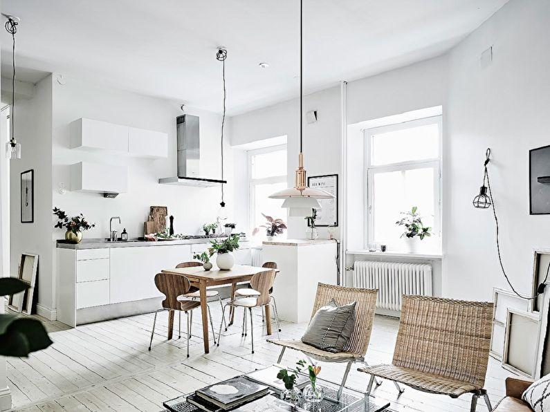 Интерьер светлой кухни деревенского дома в скандинавском стиле
