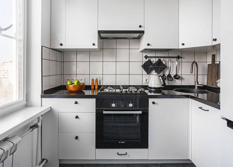 Белый кухонный гарнитур в угловой кухне