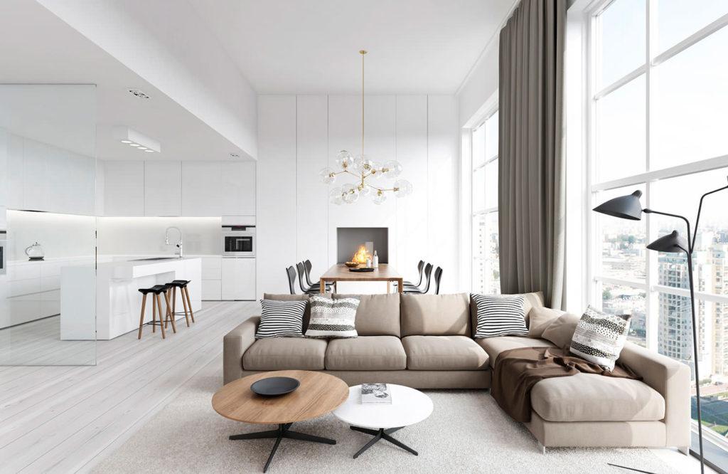 Белая кухня-гостиная с серым диваном