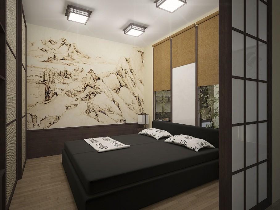 Черная кровать в спальне со светлыми стенами
