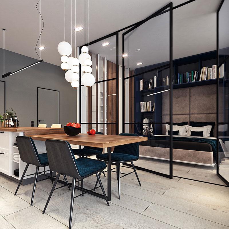 Деревянный обеденный стол в квартире студии