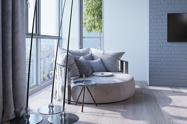 Круглый диван перед панорамным окном