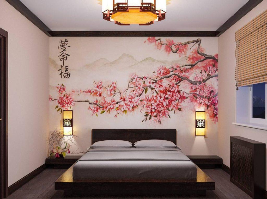 Ветки сакуры на фотообоях в спальной комнате