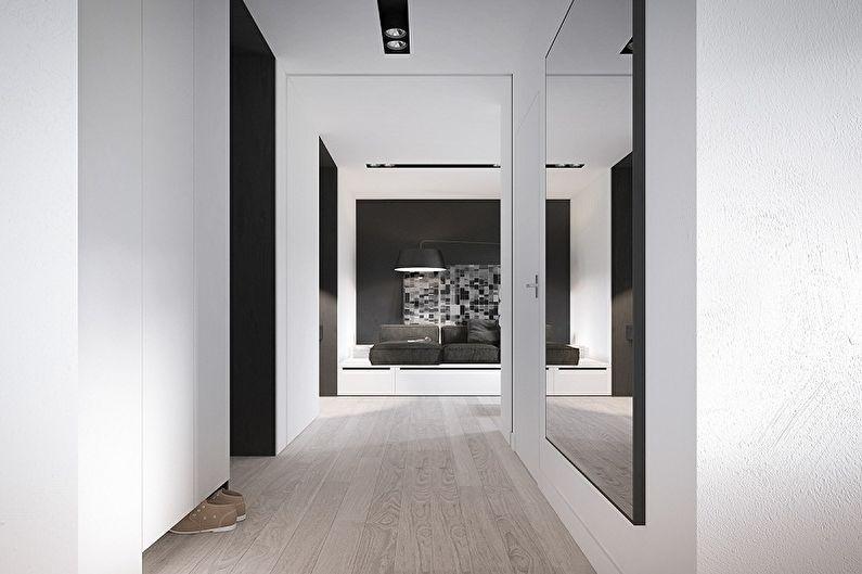 Большое зеркало на стене прихожей в стиле минимализма
