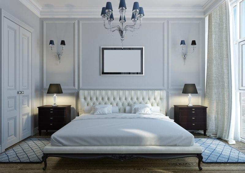 Две черные тумбочки в белой спальне