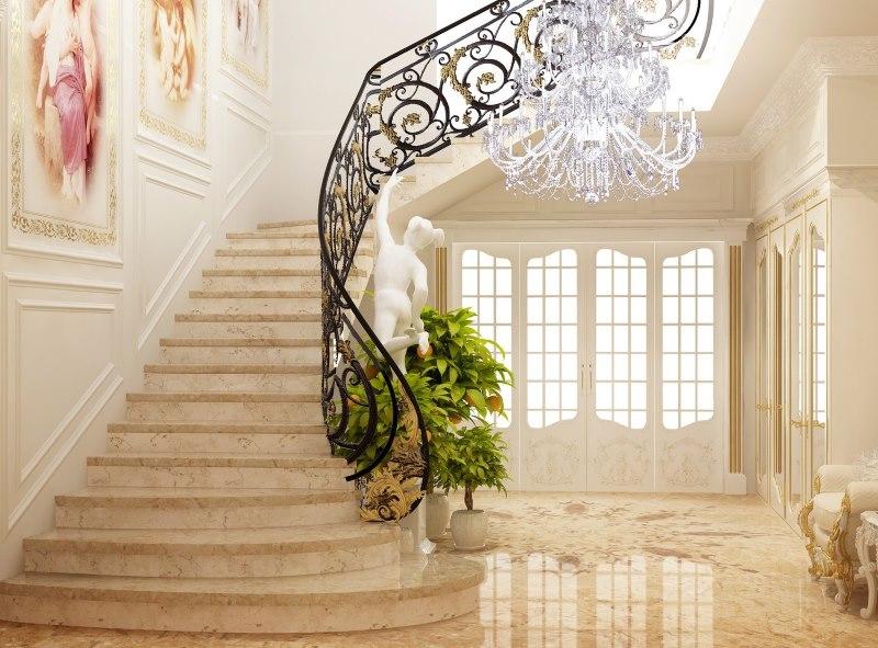 Лестница с кованными перилами в холле частного дома