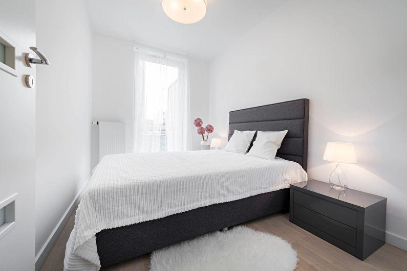 Серая кровать в белой спальне площадью в 10 кв метров