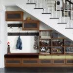 Идея оформления пространства под лестницей в прихожей