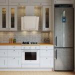 Белая наклонная вытяжка на белоснежной кухне