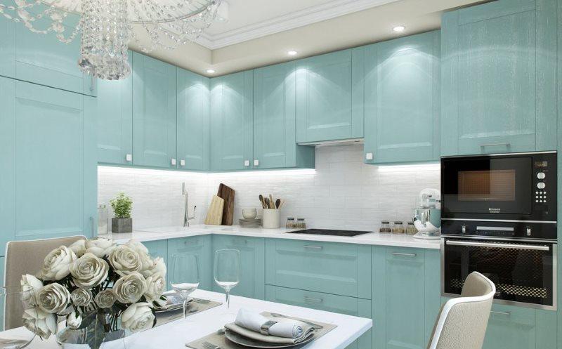 Интерьер угловой кухни с мебелью цвета мяты