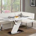 Белый угловой диванчик отлично впишется в кухню в стиле лофт