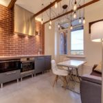 Дизайн кухни в стиле лофт с диваном