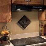 Прихватка для горячего на стене кухни
