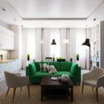 Яркий зеленый прямой диван на кухне