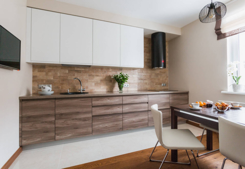 Интерьер современной кухни с фасадами без ручек