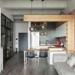 интерьер кухни-гостиной с элементами лофта
