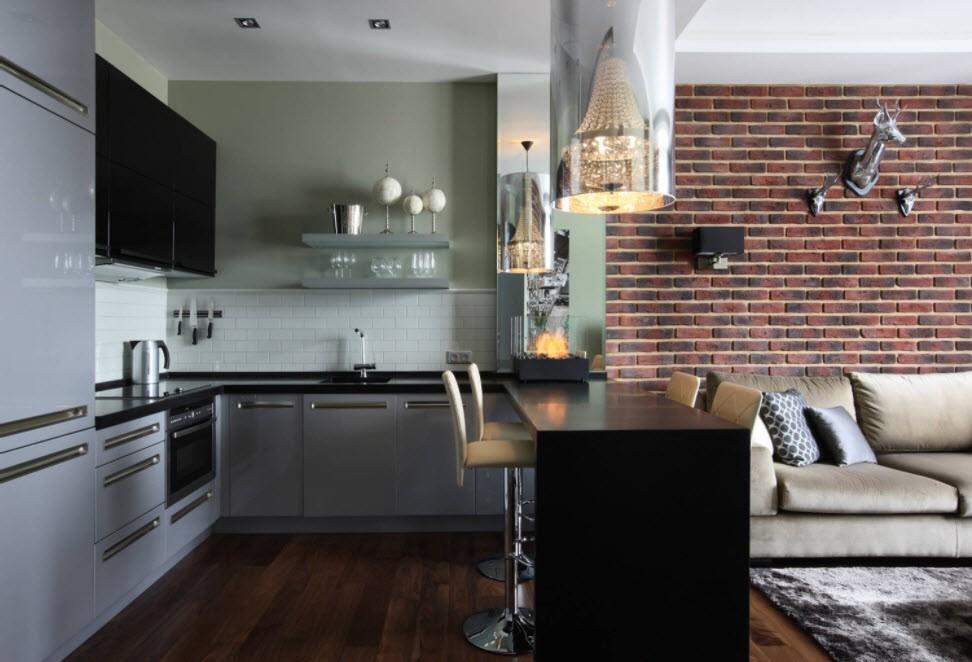 Кирпичная стена кухни в современной квартире-студии