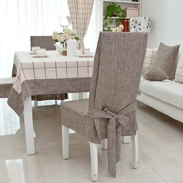 Серый чехол из натурального льна на спинке стула