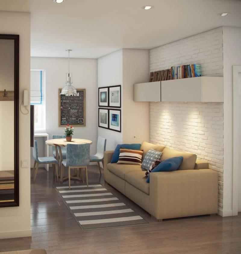 Дизайн кухонного помещения с прямым диваном