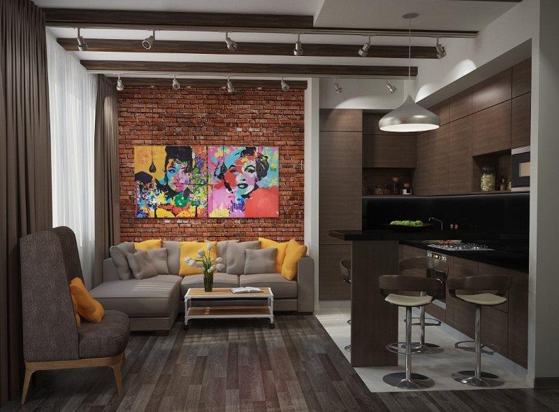 Серый диван возле кирпичной стены кухни-гостиной
