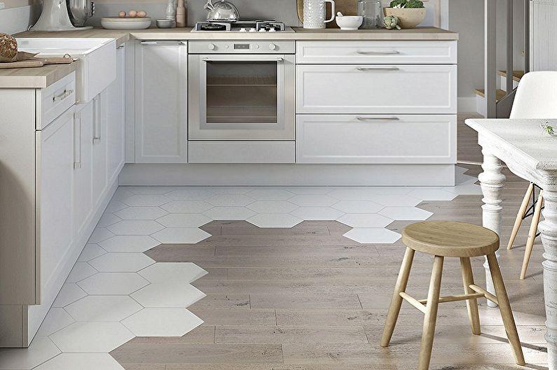 Зонирование небольшой кухни напольным покрытием