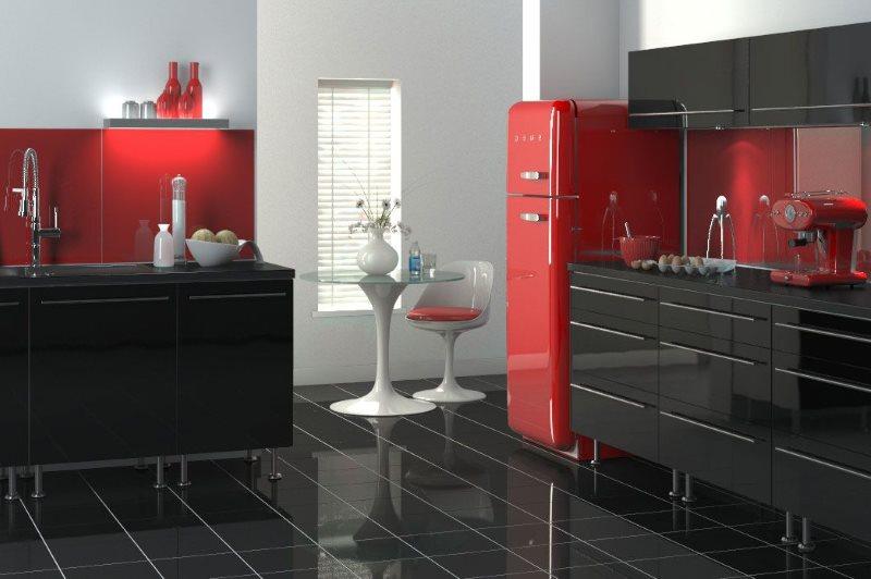Красный холодильник на кухне с черным полом