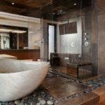 Крупная галька на полу в ванной комнате