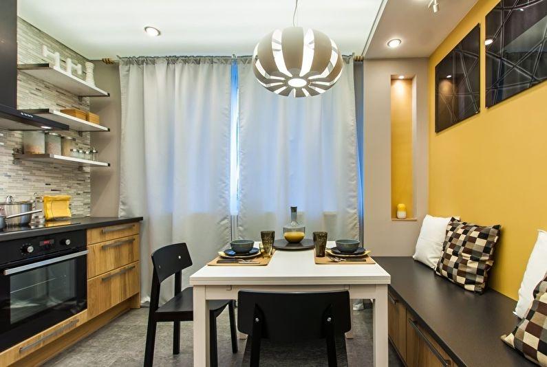 Освещение кухни с желтой стеной