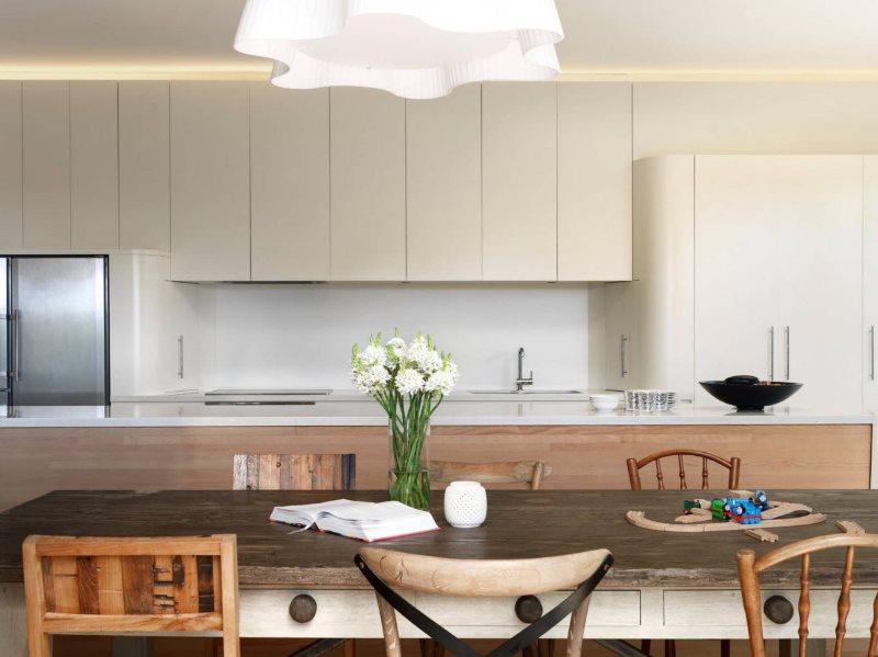Светло-серые фасады кухни в стиле минимализма