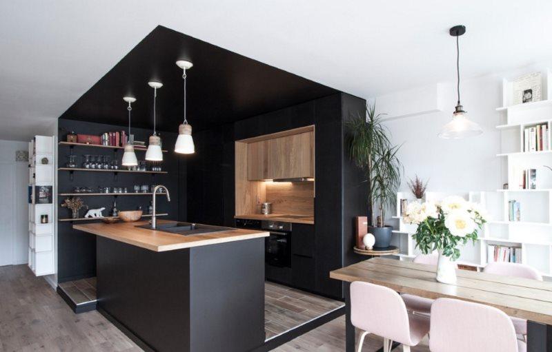 Выделение рабочей зоны кухни-гостиной с помощью подиума