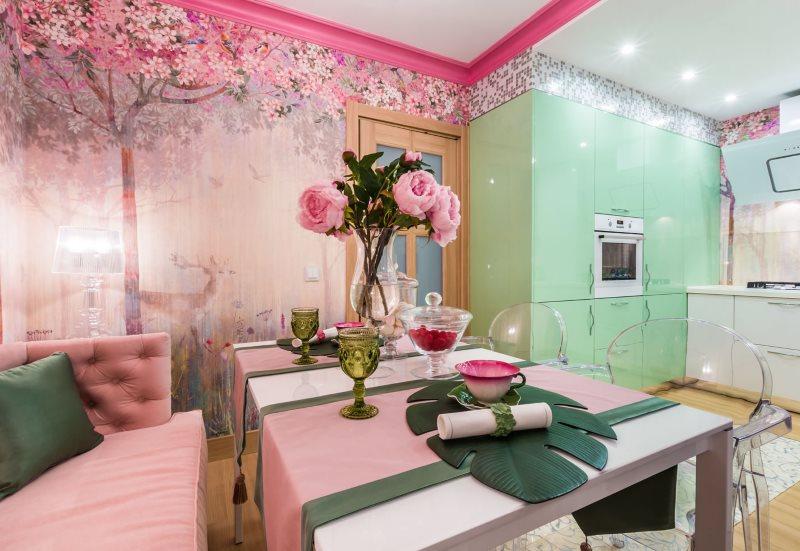 Интерьер кухни с розовыми обоями и зеленым гарнитуром