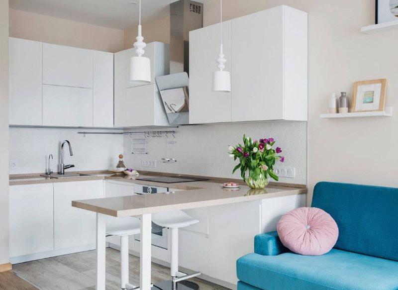 Синий диван в кухне с белым гарнитуром