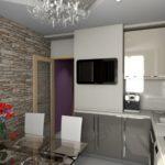 Черный телевизор на стене маленькой кухни